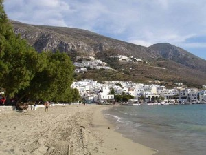 The beach with the port of Ormos and the village of Potamos above