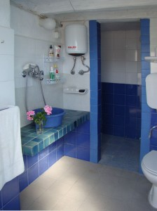Bathroom interior with tiled shower compartment